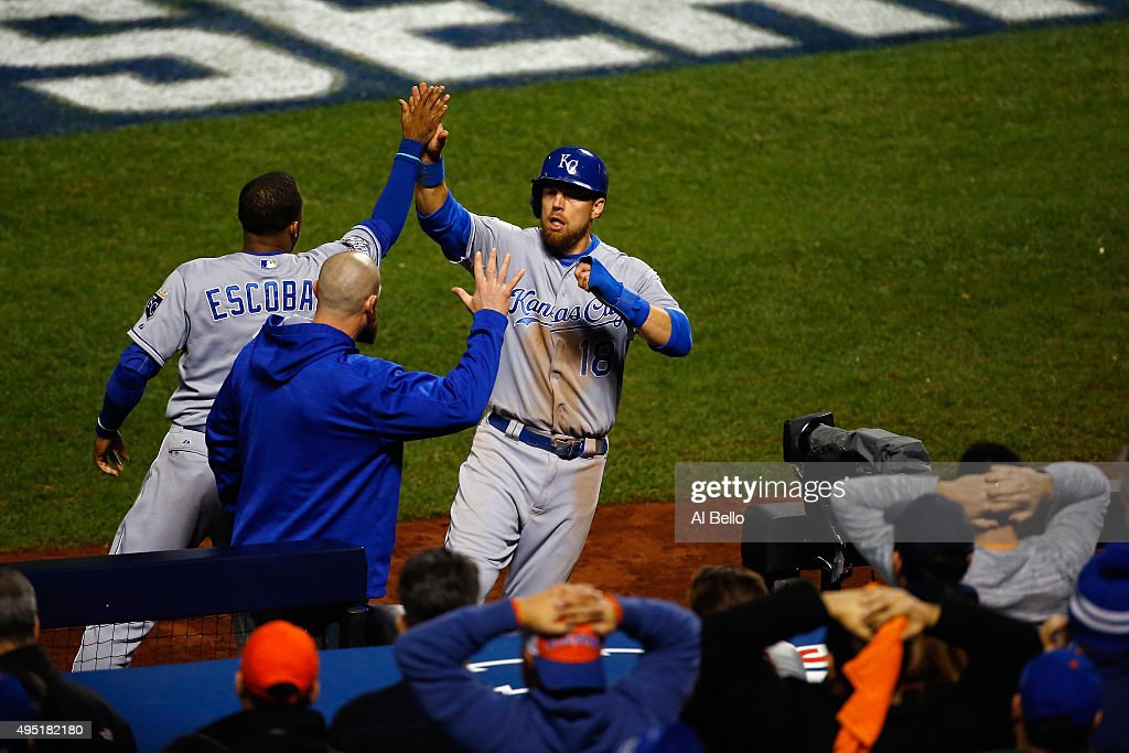 Ben Zobrist #18 of the Kansas City Royals celebrates after scoring in the eighth inning with Alcides Escobar #2 against the New York Mets during Game Four of the 2015 World Series at Citi Field on October 31, 2015 in the Flushing neighborhood of the Queens borough of New York City.