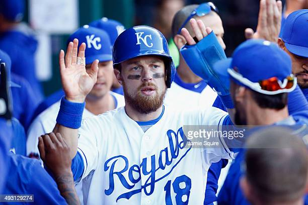 Ben Zobrist of the Kansas City Royals celebrates in the dugout after scoring a run in the seventh inning against the Toronto Blue Jays in game two of...