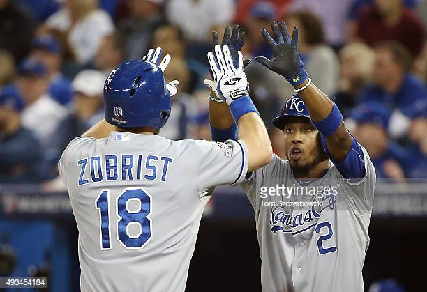 Ben Zobrist of the Kansas City Royals celebrates with Alcides Escobar of the Kansas City Royals after hitting a tworun home run in the first inning...