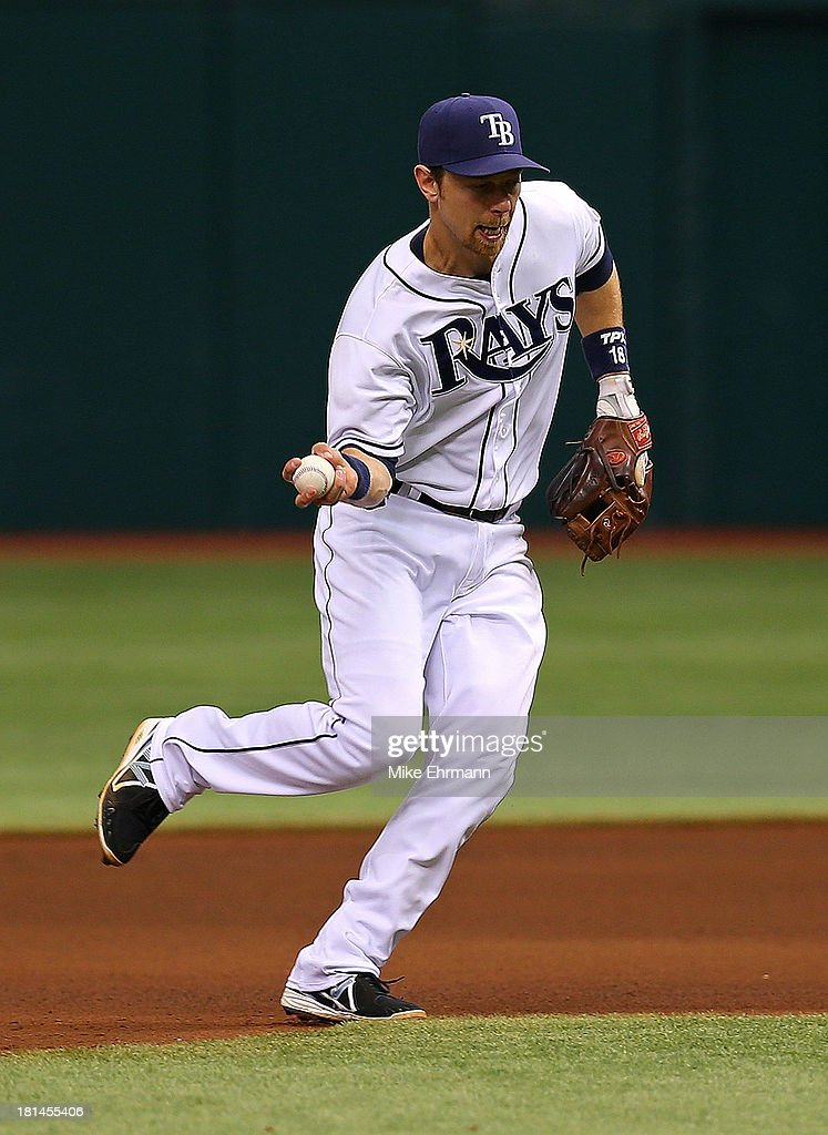<a gi-track='captionPersonalityLinkClicked' href=/galleries/search?phrase=Ben+Zobrist&family=editorial&specificpeople=2120037 ng-click='$event.stopPropagation()'>Ben Zobrist</a> #18 of the Tampa Bay Rays bare hands a ball during a game against the Baltimore Orioles at Tropicana Field on September 21, 2013 in St Petersburg, Florida.