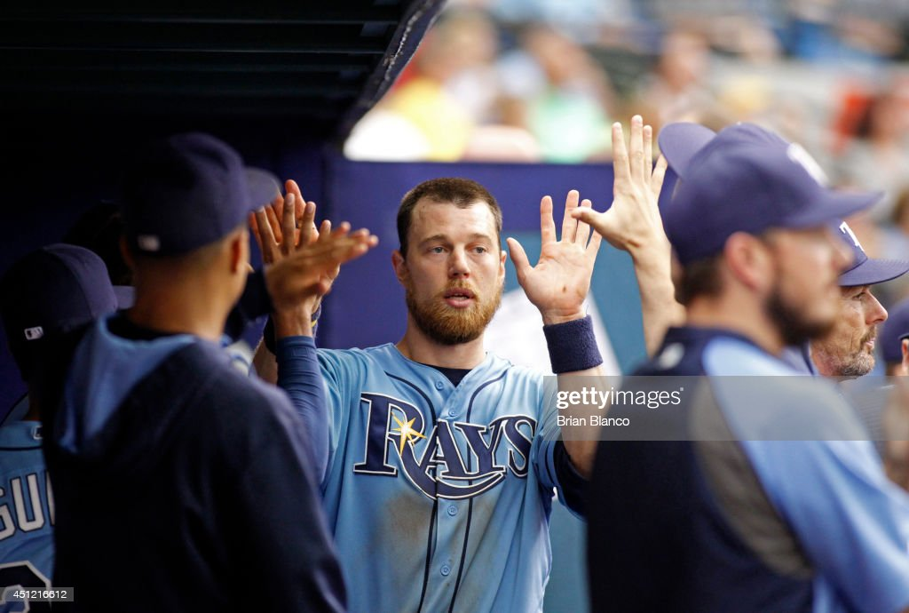 <a gi-track='captionPersonalityLinkClicked' href=/galleries/search?phrase=Ben+Zobrist&family=editorial&specificpeople=2120037 ng-click='$event.stopPropagation()'>Ben Zobrist</a> #18 of the Tampa Bay Rays celebrates in the dugout after scoring off a single by James Loney #21 of the Tampa Bay Rays during the eighth inning of a game on June 25, 2014 at Tropicana Field in St. Petersburg, Florida.