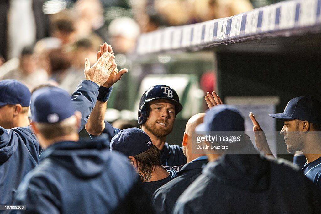 <a gi-track='captionPersonalityLinkClicked' href=/galleries/search?phrase=Ben+Zobrist&family=editorial&specificpeople=2120037 ng-click='$event.stopPropagation()'>Ben Zobrist</a> #18 of the Tampa Bay Rays celebrates the go-ahead run in the 10th inning of a game against the Colorado Rockies at Coors Field on May 3, 2013 in Denver, Colorado. The Rays beat the Rockies 7-4 in ten innings.