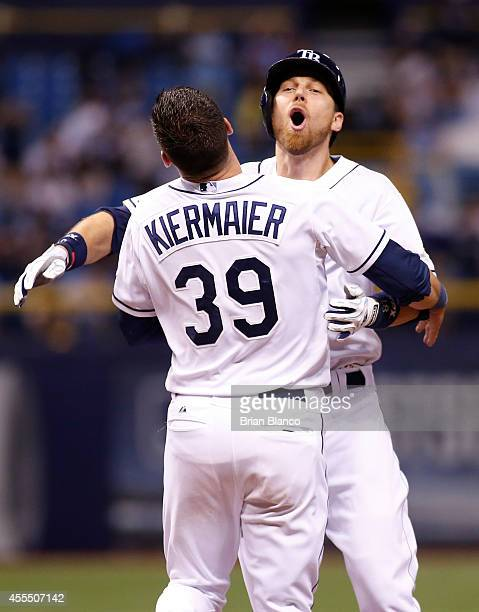 Ben Zobrist of the Tampa Bay Rays celebrates with Kevin Kiermaier following Zobrist's walk off single with the bases loaded to score Logan Forsythe...