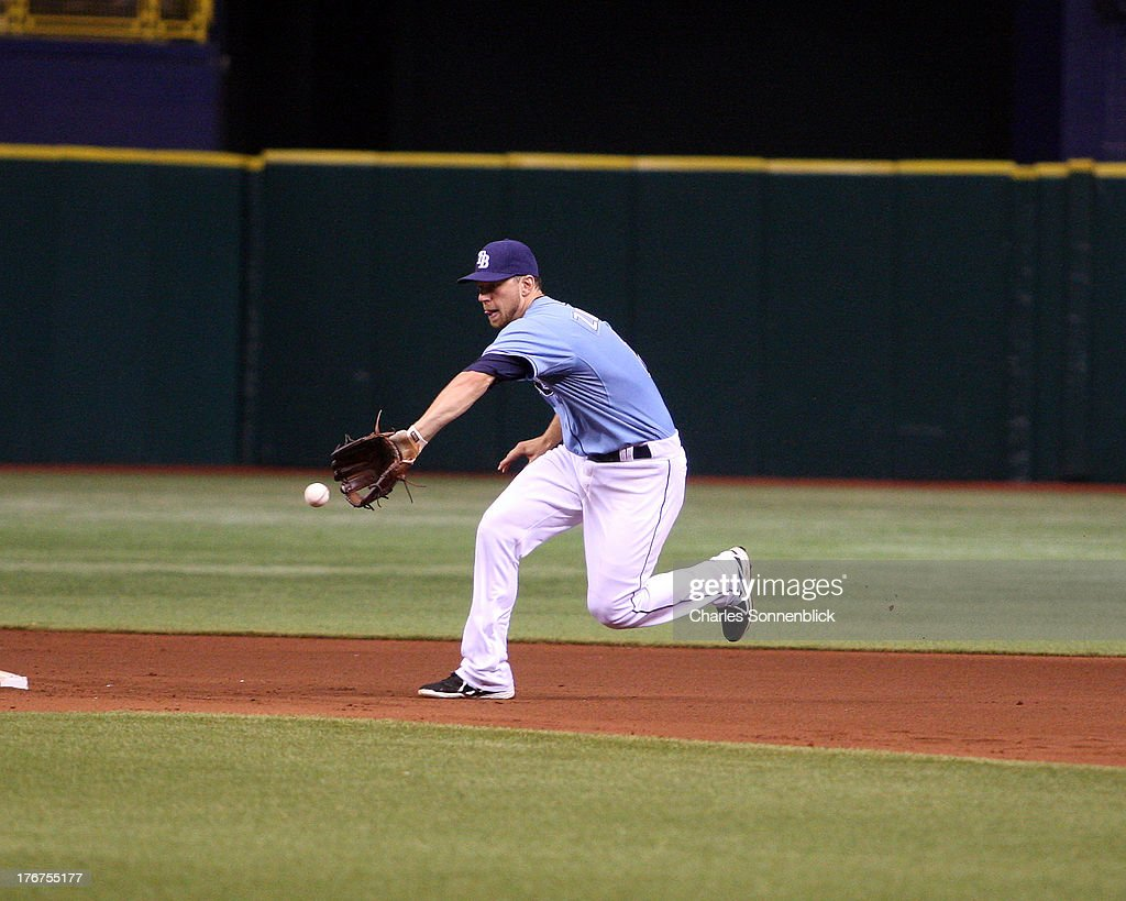 Ben Zobrist #18 of the Tampa Bay Rays fiields a ground ball in the fourth inning against the Toronto Blue Jays during the game on August 18, 2013 at Tropicana Field in St. Petersburg, Florida.