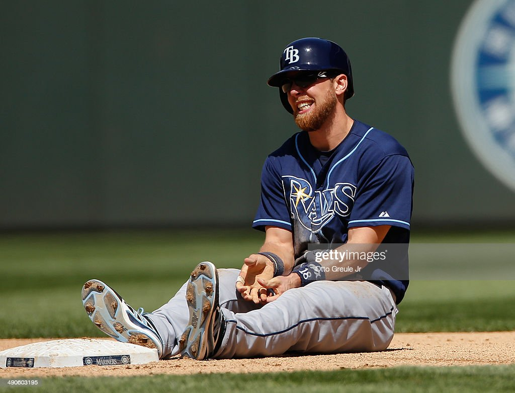 <a gi-track='captionPersonalityLinkClicked' href=/galleries/search?phrase=Ben+Zobrist&family=editorial&specificpeople=2120037 ng-click='$event.stopPropagation()'>Ben Zobrist</a> #18 of the Tampa Bay Rays holds his left thumb after dislocating it attempting to steal second base in the fifth inning against the Seattle Mariners at Safeco Field on May 14, 2014 in Seattle, Washington. The Rays defeated the Mariners 2-0.