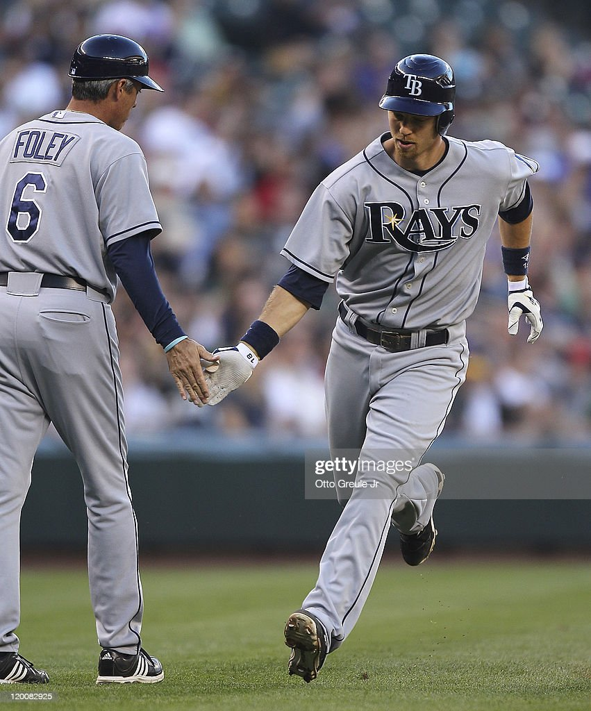 Ben Zobrist #18 of the Tampa Bay Rays is congratulated by third base coach Tom Foley #6 after hitting a two-run home run in the second inning against the Seattle Mariners at Safeco Field on July 29, 2011 in Seattle, Washington.