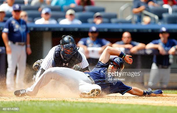 Ben Zobrist of the Tampa Bay Rays is tagged out in the fifth inning by Brian McCann of the New York Yankees at Yankee Stadium on July 2 2014 in the...