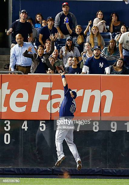 Ben Zobrist of the Tampa Bay Rays makes a catch at the wall for an out in the third inning against the Tampa Bay Rays at Yankee Stadium on September...