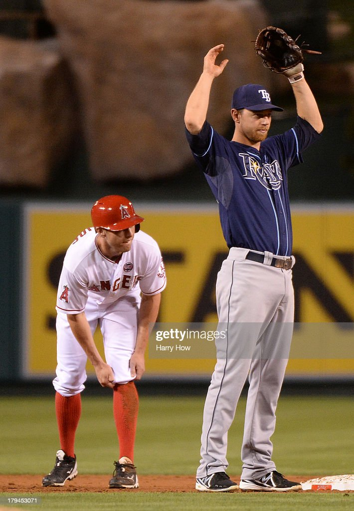 <a gi-track='captionPersonalityLinkClicked' href=/galleries/search?phrase=Ben+Zobrist&family=editorial&specificpeople=2120037 ng-click='$event.stopPropagation()'>Ben Zobrist</a> #18 of the Tampa Bay Rays reacts to a missed double play in front of <a gi-track='captionPersonalityLinkClicked' href=/galleries/search?phrase=Peter+Bourjos&family=editorial&specificpeople=4959085 ng-click='$event.stopPropagation()'>Peter Bourjos</a> #25 of the Los Angeles Angels during the second inning at Angel Stadium of Anaheim on September 3, 2013 in Anaheim, California.