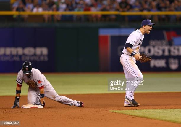 Ben Zobrist of the Tampa Bay Rays reacts to Quintin Berry of the Boston Red Sox being called safe as he steals second base in the eighth inning...