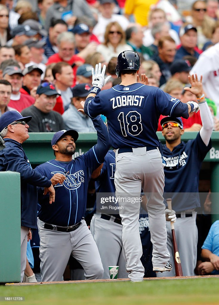 Ben Zobrist #18 of the Tampa Bay Rays returns to the dugout after hitting a home run in the fourth inning against the Boston Red Sox during Game One of the American League Division Series at Fenway Park on October 4, 2013 in Boston, Massachusetts.