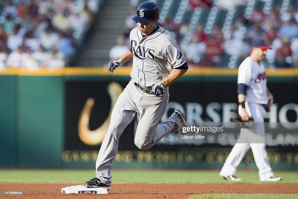 <a gi-track='captionPersonalityLinkClicked' href=/galleries/search?phrase=Ben+Zobrist&family=editorial&specificpeople=2120037 ng-click='$event.stopPropagation()'>Ben Zobrist</a> #18 of the Tampa Bay Rays rounds second base after hitting a tworun home run during the first inning against the Cleveland Indians at Progressive Field on July 6, 2012 in Cleveland, Ohio.
