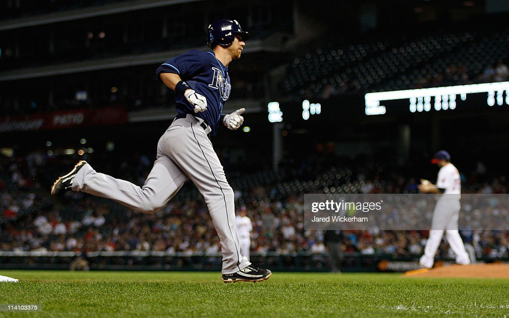 <a gi-track='captionPersonalityLinkClicked' href=/galleries/search?phrase=Ben+Zobrist&family=editorial&specificpeople=2120037 ng-click='$event.stopPropagation()'>Ben Zobrist</a> #18 of the Tampa Bay Rays trots around third base after hitting a home run off of <a gi-track='captionPersonalityLinkClicked' href=/galleries/search?phrase=Justin+Germano&family=editorial&specificpeople=803395 ng-click='$event.stopPropagation()'>Justin Germano</a> #39 of the Cleveland Indians during the game on May 11, 2011 at Progressive Field in Cleveland, Ohio.