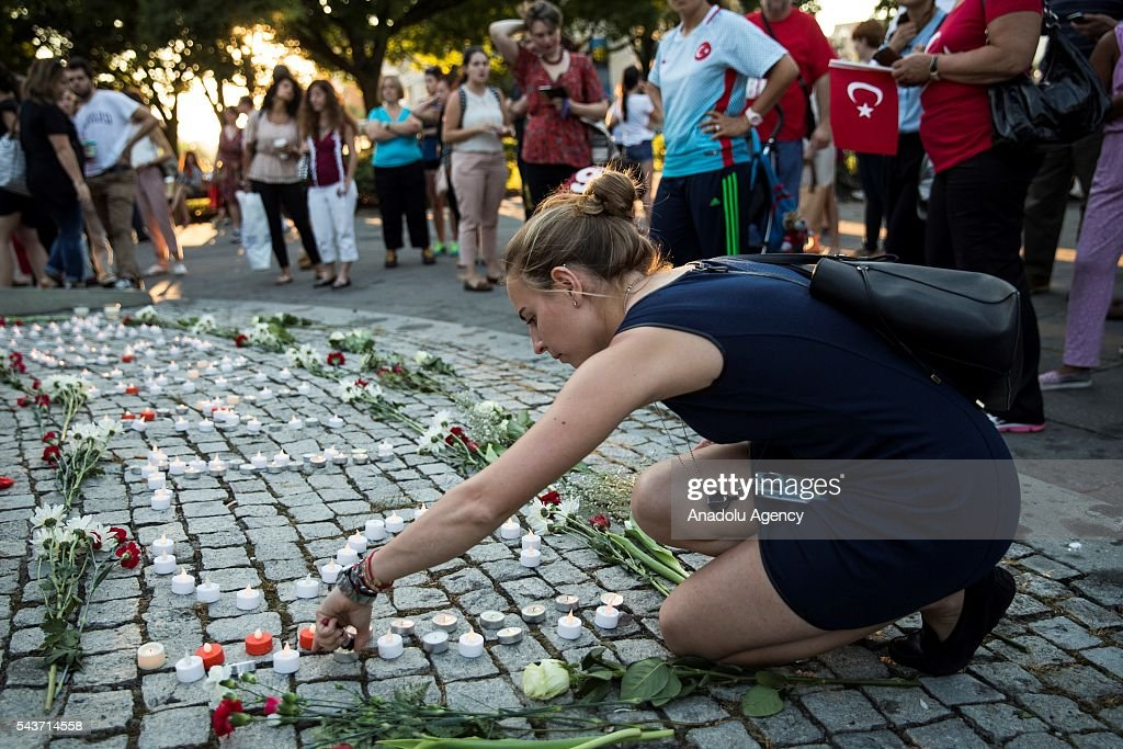 Benan Berhan from Istanbul lights and candle in Dupont Circle during a vigil for the victims of the Istanbul Airport terrorist attack Washington, USA on June 29, 2016.