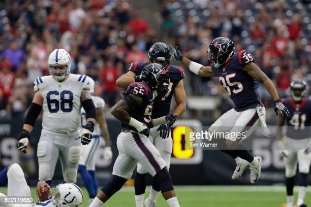 Benardrick McKinney of the Houston Texans celebrates with Eddie Pleasant and Brennan Scarlett after sacking Jacoby Brissett of the Indianapolis Colts...