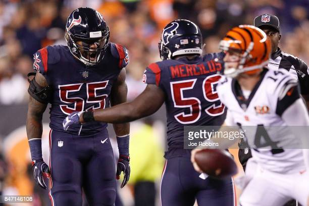 Benardrick McKinney of the Houston Texans celebrates with Whitney Mercilus after sacking Andy Dalton of the Cincinnati Bengals during the first half...