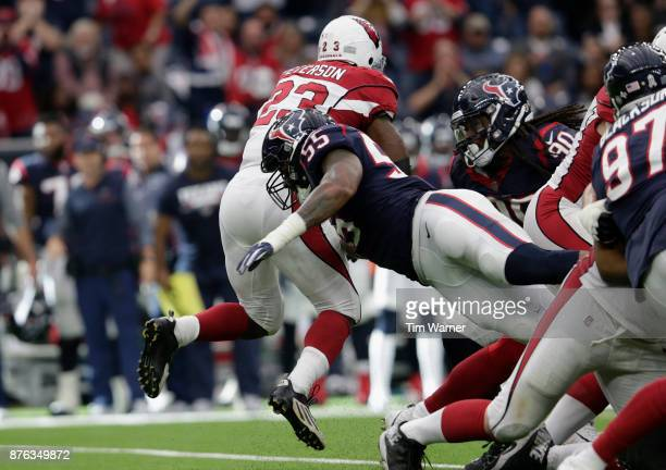 Benardrick McKinney of the Houston Texans hits Adrian Peterson of the Arizona Cardinals behind the line of scrimmage in the fourth quarter at NRG...