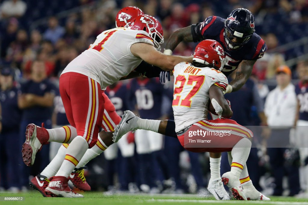 Benardrick McKinney #55 of the Houston Texans tackles Kareem Hunt #27 of the Kansas City Chiefs in the second half at NRG Stadium on October 8, 2017 in Houston, Texas.