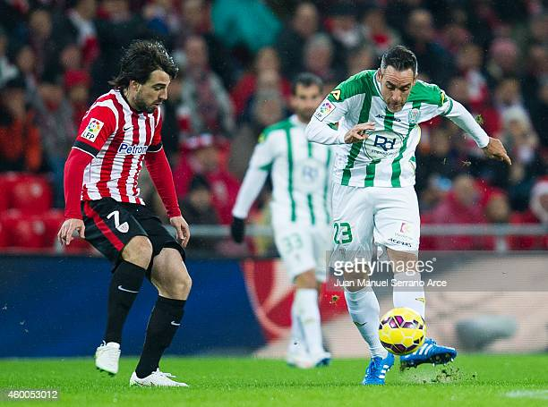 Benat Etxebarria of Athletic Club duels for the ball with Abel Gomez of Cordoba CF during the La Liga match between Athletic Club and Cordoba CF at...
