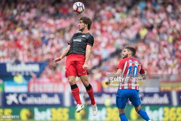 Benat Etxebarria Urkiaga of Athletic Club vies for the ball with Yannick Ferreira Carrasco of Atletico de Madrid during the La Liga match between...