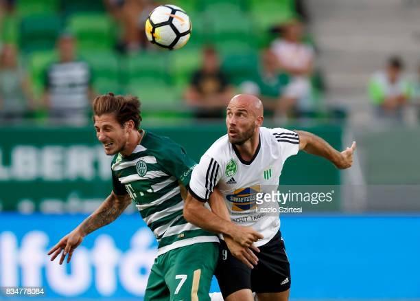 Bence Batik of Ferencvarosi TC battles for the ball in the air with Miroslav Grumic of Swietelsky Haladas during the Hungarian OTP Bank Liga match...