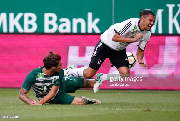 Bence Batik of Ferencvarosi TC fouls David Williams of Swietelsky Haladas during the Hungarian OTP Bank Liga match between Ferencvarosi TC and...