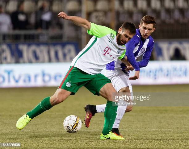 Bence Pavkovics of Ujpest FC competes for the ball with Daniel Bode of Ferencvarosi TC during the Hungarian OTP Bank Liga match between Ujpest FC and...