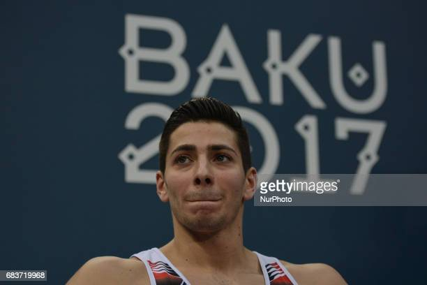 Bence Talas of Azerbaijan after finishing the competition in the Men's Horizontal Bar final in Artistic Gymnastics during day four of Baku 2017 4th...