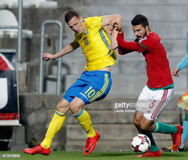 Bence Toth of Hungary U21 fights for the ball with Gustaf Nilsson of Sweden U21 during the UEFA Under 21 Euro 2019 Qualifier match between Hungary...