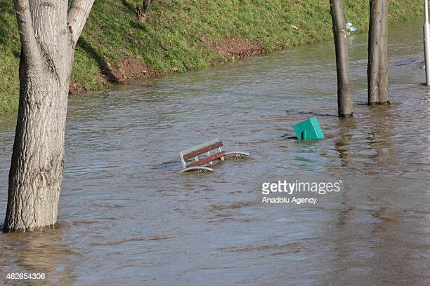 A bench and a garbage are seen inside the flood water caused by the overflowed rivers following heavy rains in Stip Macedonia on February 02 2015 Due...