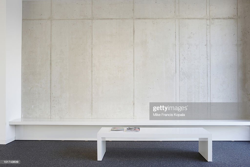 Bench and table in modern office lobby