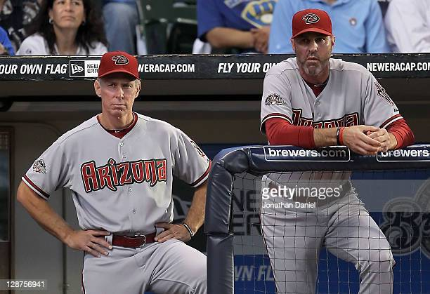 Bench coach Alan Trammell and manager Kirk Gibson of the Arizona Diamondbacks stand at the top of the dugout in the fourth inning as the Diamondbacks...