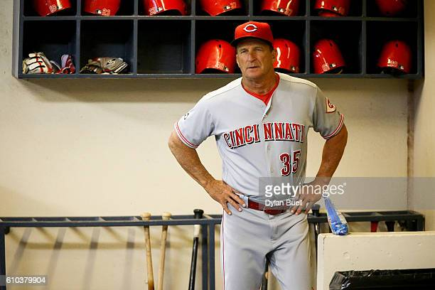 Bench coach Jim Riggleman of the Cincinnati Reds stands in the dugout before the game against the Milwaukee Brewers at Miller Park on September 23...