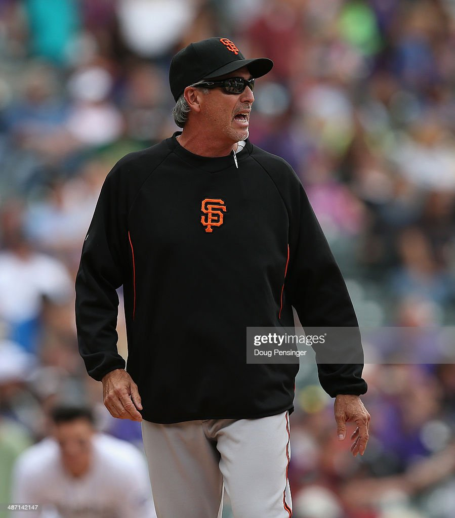 Bench coach Ron Wotus #23 of the San Francisco Giants takes over for manager Bruce Bochy #15 of the San Francisco Giants after Bochy was ejected against the Colorado Rockies at Coors Field on April 23, 2014 in Denver, Colorado. The Giants defeated the Rockies 12-10 in 11 innings.