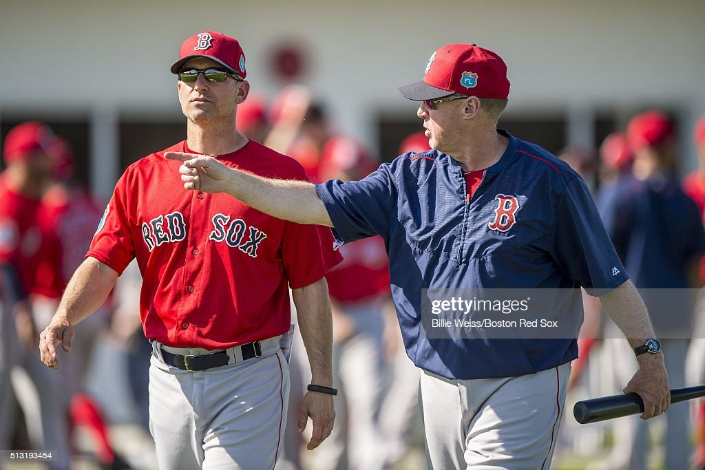 Bench coach Torey Lovullo and third base coach Brian Butterfield of the Boston Red Sox talk during a team workout on March 1, 2016 at Fenway South in Fort Myers, Florida .
