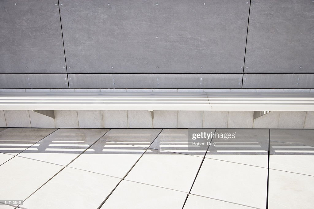 Bench in modern office building courtyard : Stock Photo