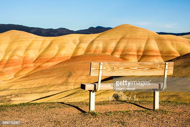 A bench next to a dramatic landscape in Oregon.
