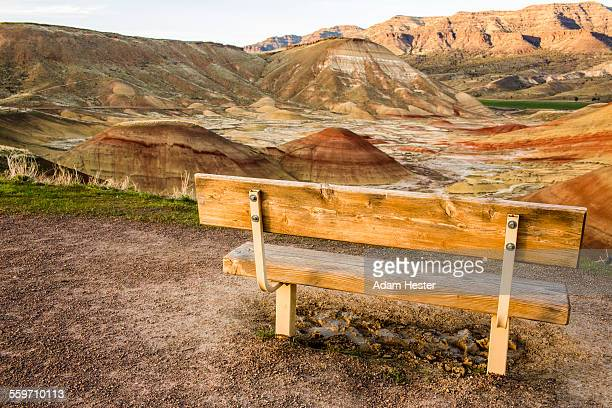 A bench next to a dramatic landscape in Oregon