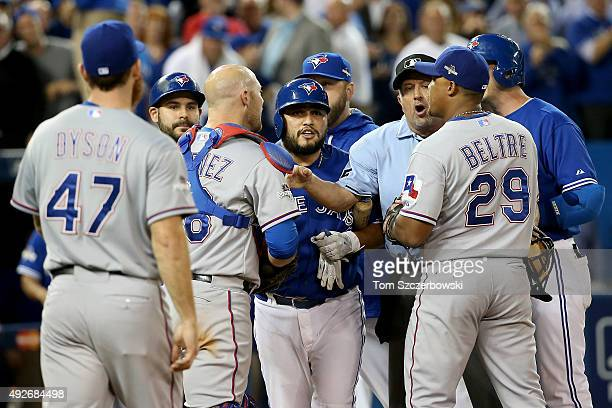 Benches clear as Chris Gimenez of the Texas Rangers and Troy Tulowitzki of the Toronto Blue Jays exchange words in the seventh inning in game five of...