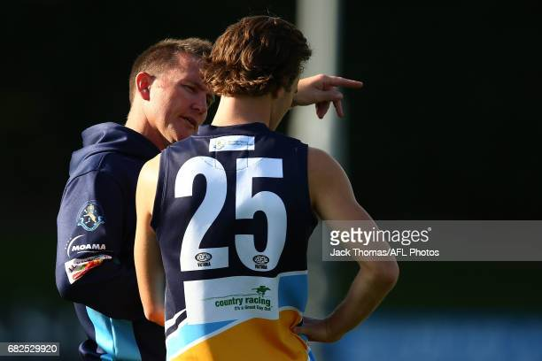 Bendigo Pioneers coach Rick Coburn talks to Lewin Davis of the Pioneers at quarter time during the round seven TAC Cup match between the Eastern...