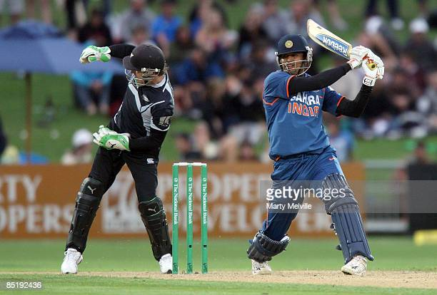 Bendon McCullum keeper for the Blackcaps injures his hand from a delivery past Yusuf Pathan of India during the first one day international match...