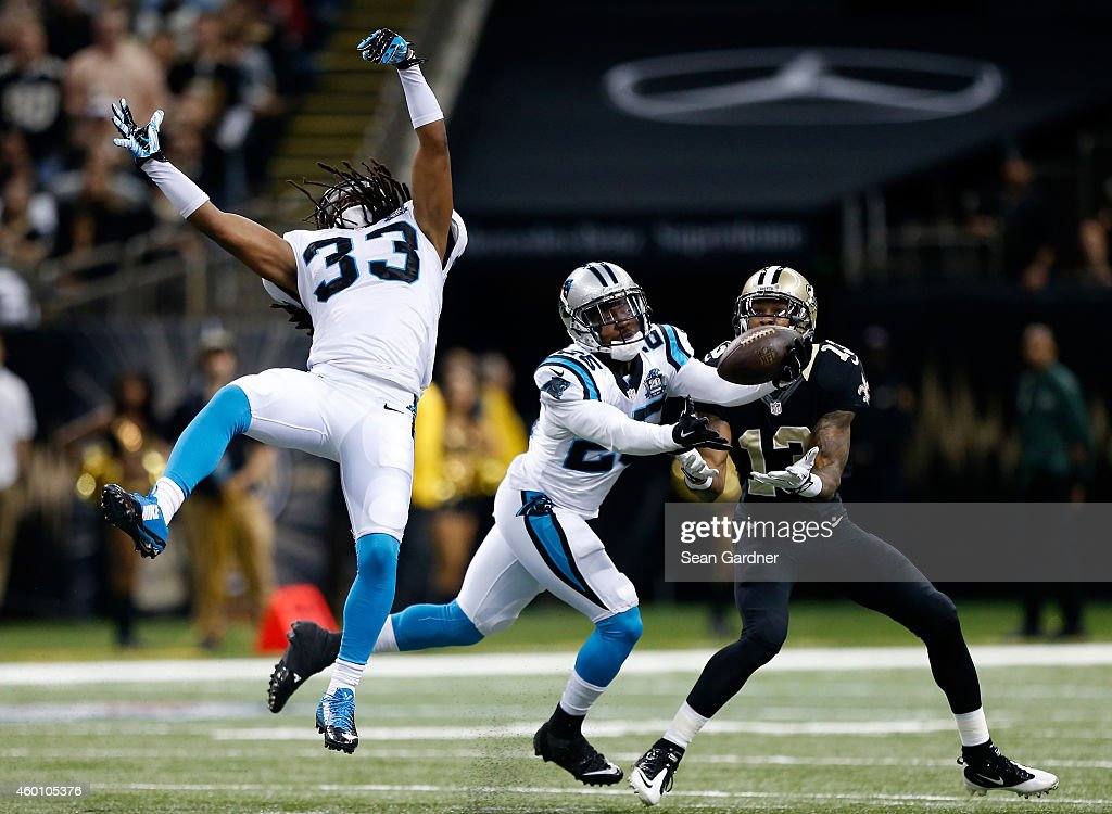 Bene' Benwikere #25 of the Carolina Panthers intercepts a pass intended for Joseph Morgan #13 of the New Orleans Saints during the first quarter at Mercedes-Benz Superdome on December 7, 2014 in New Orleans, Louisiana.