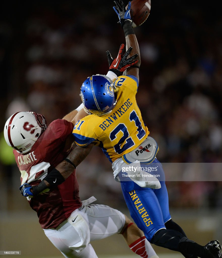 Bene Benwikere #21 of the San Jose State Spartans breaks up this pass to Devon Cajuste #89 of the Stanford Cardinal in during the third quarter at Stanford Stadium on September 7, 2013 in Palo Alto, California. Stanford won the game 34-13.
