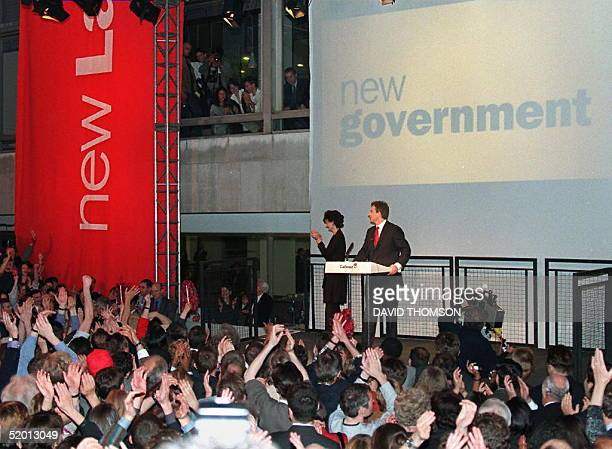 Beneath a flashed banner reading 'new government' the new British Prime Minister Tony Blair and his wife Cherie enjoy the adulation of their Labour...