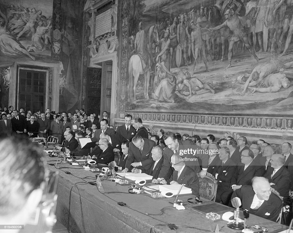 Beneath a fresco of The Horatii and Curatii by D'Arpino statesmen of six European countries sign treaties for a European Common Market and European...