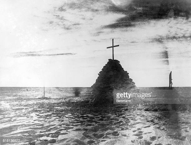 Beneath this sepulcher of snow on the surface of the great ice barrier lie the bodies of Captain Robert Falcon Scott Dr Wilson and Lieutenant Bowers...