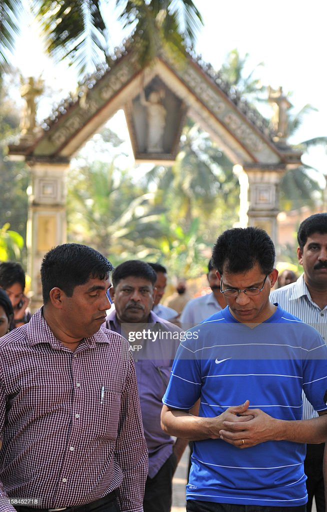 Benedict Barbosa (R), husband of late Indian nurse Jacintha Saldanha (R) speaks after inspecting the preperations of the grave at The Shirva Church Cemetery, near Mangalore, on December 17, 2012. Family and friends of the nurse who was found hanged after taking a hoax call to the hospital treating Prince William's wife are preparing for her funeral in a small town in southwest India. Indian-born Jacintha Saldanha, 46, apparently committed suicide after answering the telephone call from two Australian radio DJs to the hospital where the pregnant Duchess of Cambridge was admitted with acute morning sickness. AFP PHOTO/Manjunath Kiran