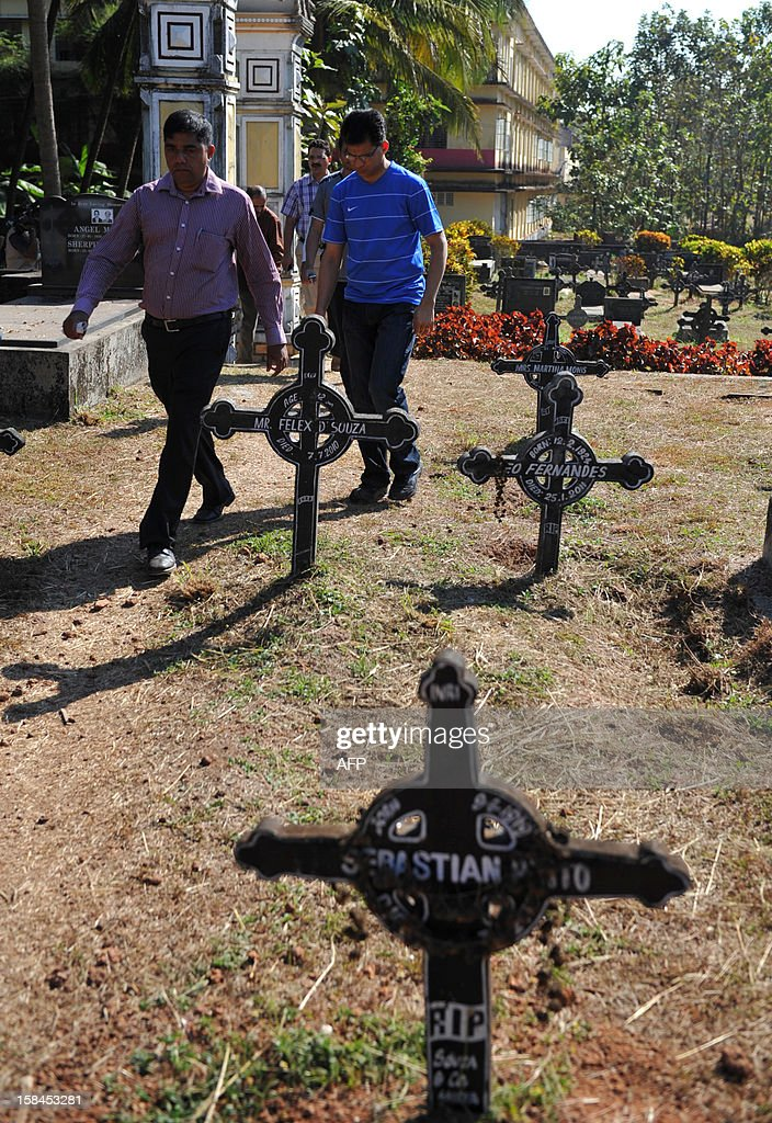 Benedict Barbosa (R), husband of the late Indian nurse Jacintha Saldanha, arrives to inspect preparations of her grave at The Shirva Church Cemetery, near Mangalore on December 17, 2012. Family and friends of the nurse who was found hanged after taking a hoax call to the hospital treating Prince William's wife are preparing for her funeral in a small town in southwest India. Indian-born Jacintha Saldanha, 46, apparently committed suicide after answering the telephone call from two Australian radio DJs to the hospital where the pregnant Duchess of Cambridge was admitted with acute morning sickness. AFP PHOTO/Manjunath Kiran
