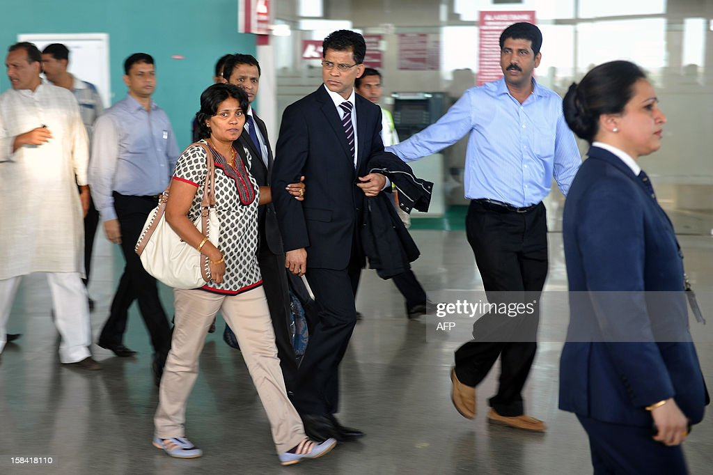 Benedict Barboza (C) the husband of India-born nurse Jacintha Saldanha, 46, walks through the airport after his wife's coffin arrived at the Bajpe Airport in Mangalore on December 16, 2012. The body of Saldanha who was found hanged after taking a hoax call to the hospital treating Prince William's wife arrived in Mangalore following a memorial mass in London. AFP PHOTO/ Manjunath KIRAN