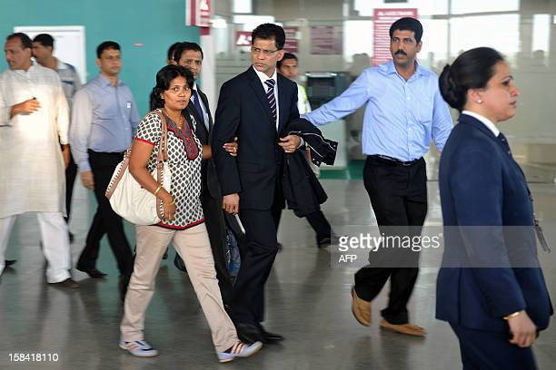 Benedict Barboza the husband of Indiaborn nurse Jacintha Saldanha walks through the airport after his wife's coffin arrived at the Bajpe Airport in...